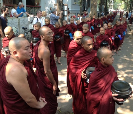 The feeding of the faithfull! A thousand Monks waiting for lunch. Maha Aungmye Bonzan Monastery, Amarapura