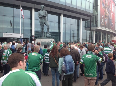 Yeovil fans respectfully waiting to meet up by the famed Bobby Moore statue - hero and captain of England's 1966 World Cup winning team.
