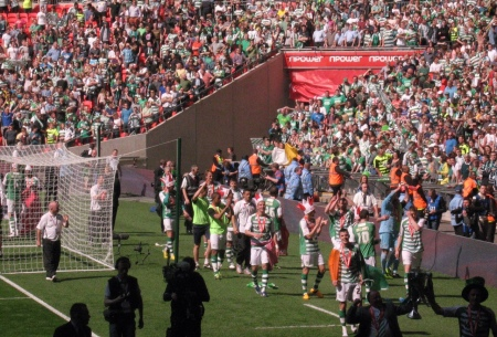 The victorious team makes a lap of honour before their fans.