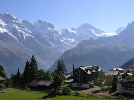 The cowshed at Busenalp is clearly above the tree line on the right side of the dark middle distance ridge. This picture was taken from the writer's home in Murren.