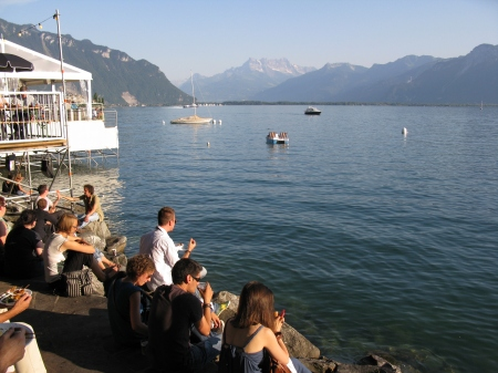 Festivalgoers enjoy a pre concert drink on the shores of Lake Geneva