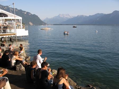 Festivalgoers enjoy a pre concert drink on the shores of Lake Geneva