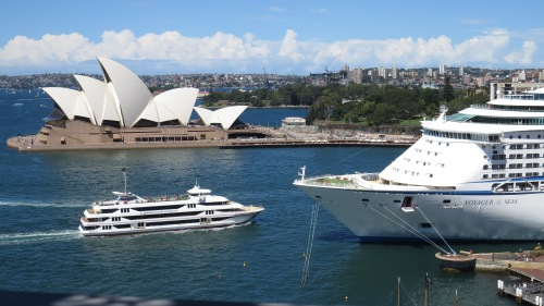 John Utzon's innovative design 1960s design for the Opera House envisioned the roof would blend with the Sails of boats on the Harbour but it also brilliantly complements pleasure craft and ocean liners as illustrated by this view from the Harbour Bridge.