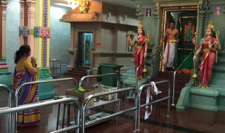 Devotee greets Priest at the Sri Maha Mariamman Temple.