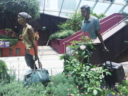 17 Bruno Catalano's sculpture 'La Famille de Voyageurs' (The Travelling Family) is on display in the Flower Dome.